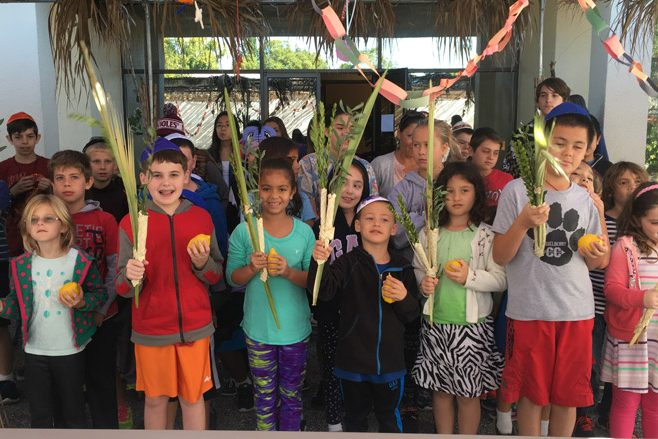 MAGAL students practicing with their lulav and etrog for Sukkot!